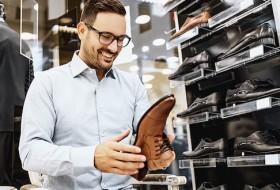 man buying shoes
