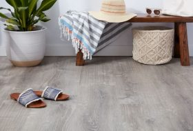 vinyl flooring for home with table plants towel hat and sunglasses on it