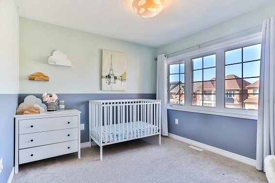 picture of nurcery with bed and baby dresser